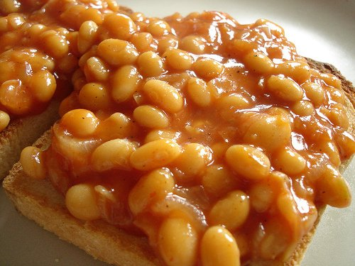 ... point by handing out cans of baked beans to unsuspecting passers by
